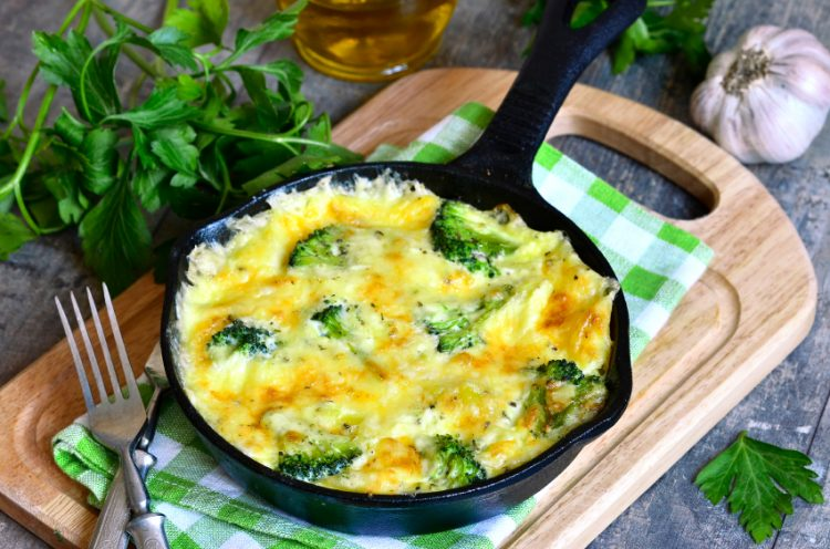 Frittata with potato and broccoli in a frying pan.