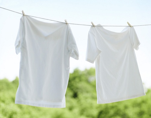 T-shirts Hanging out to Dry --- Image by © Royalty-Free/Corbis