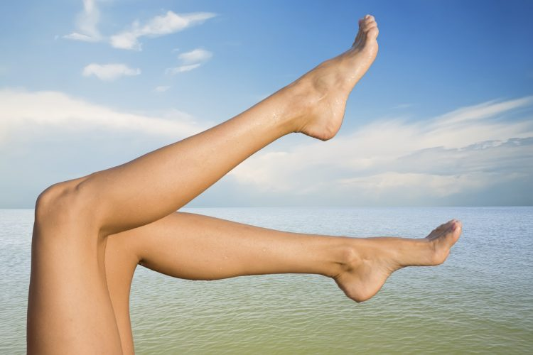Picture of beautiful female legs on sky background